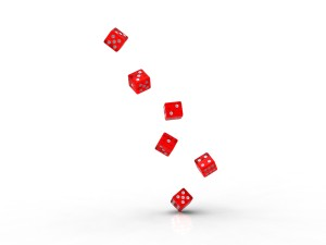 six translucent red casino dice being thrown roll off